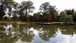 The central temple of Banteay Srei surrounded by a moat.