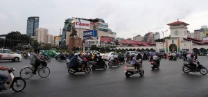 Motorists driving past the Ben Thanh market.