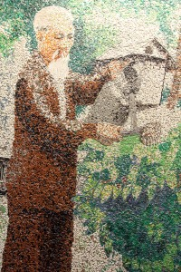 Artwork of Ho Chi Minh watering some plants.