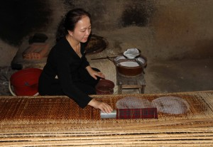 Woman making rice paper.