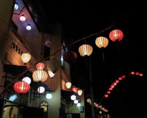 Paper lanterns hanging from restaurants along the waterfront in Hoi An.