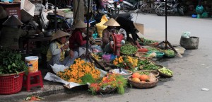 Women selling flowers and vegetables in the near the Central Market in Hoi An.