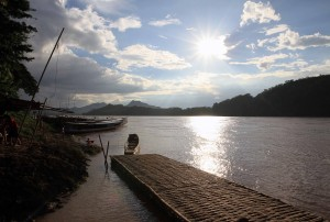 Staring in the sun as it begins to set over the Mekong River.