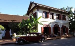 Historic building and car in Luang Prabang.