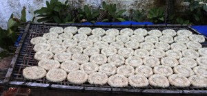 Rice cakes drying outside.