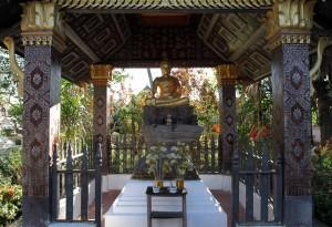 Buddha statue underneath a shelter at Wat Xieng Toung.