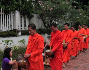 Closeup of the monks receiving food from the locals.