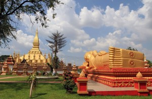The reclining Buddha with Pha That Luang in the background.