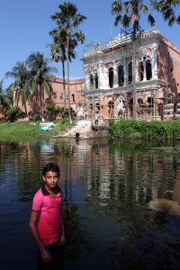 Young boy posing in the water (I didn't ask him to go in, he just did so I could take a photo of him) in front of Bara Sardar Bari.