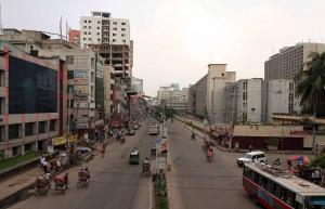 Street in Dhaka seen from a pedestrian overpass.