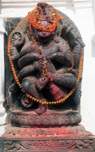 Hindu sculpture with flower wreaths.