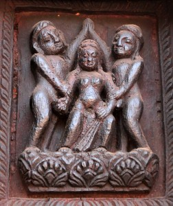 Erotic wood relief found on the temple in Duttatraya Square - the two guys are high-fiving each other as a woman gives them each a hand-job.