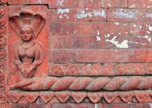 Terracotta sculpture adorning a building at Buddha Nilkantha Temple.