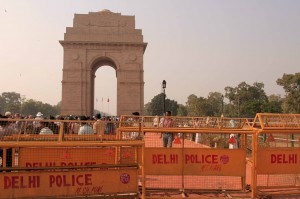 The India Gate with police barricades off to one side.