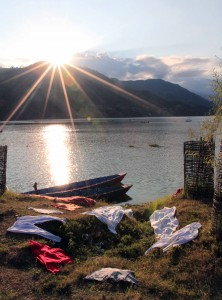 Laundered clothes drying in the last streams of sunshine before dusk, seen from the Lakeside walk in Pokhara.