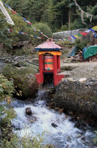 A large prayer wheel cleverly set up to run on hydraulic power so it continually prays.