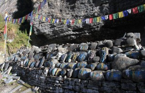 A Mani wall alongside the trail - a Mani wall consists of stones inscribed with mantras or devotional symbols.