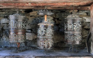 Prayer wheels with the middle wheel's lid off.