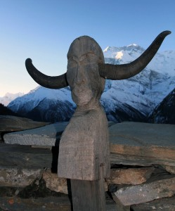 Wood sculpture with yak horns.