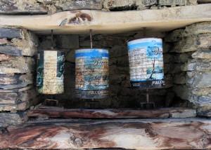 Reusing old cream milk cans as prayer wheels.