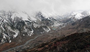 The Marsyangdi Nadi valley with snow flurry laden clouds moving in.