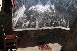 The rooftop terrace of the guesthouse I stayed at in Khangsar - the yak hide is used to warm your feet.