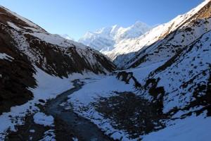 The Kone Khola residing in the mountains' shadow.