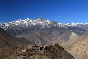 Jharkot, located at the edge of a cliff, with the mountains of Upper Mustang in the background.