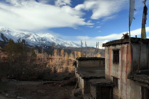 Looking out at the Muktinath valley next to a striped home in Chongur.