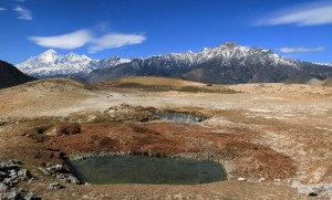 Small ponds with the mountains of Upper Mustang in the distance.