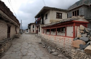 Prayer wheel wall and Mani stones in the old part of Tukuche.