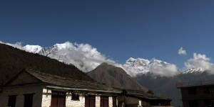 Annapurna I in the afternoon, slightly covered in clouds.
