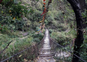 A creaky wooden suspension bridge over the Kali Gandaki Nadi.
