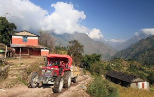 Tractor traveling on the dirt road in Ghara.