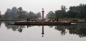 Pillar and statue near the Lumbini Museum.