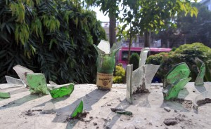 Using broken liquor bottles to keep criminals off one's property.