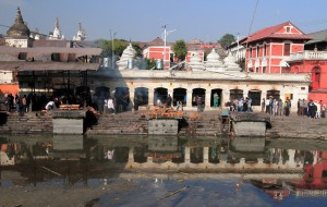 Body being cremated along the Bagmati River at the Pashupatinath Temple complex.