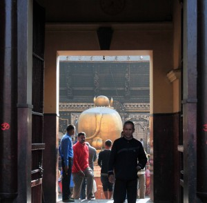 Looking through the entrance of the Pashupatinath Temple, at the giant golden bull with massive cojones.