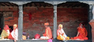 Women sitting around at the Pashupatinath Temple complex.