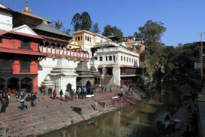 Two deceased bodies covered in cloth, awaiting cremation in Pashupatinath.