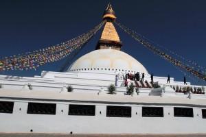 Bouddhanath Stupa with many prayer wheels along its walls.