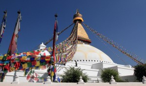 Bouddhanath Stupa with many prayer flags hanging from each corner.