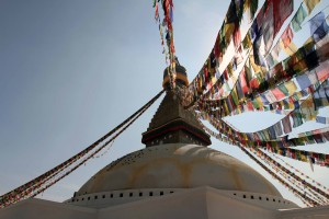 Prayer flags hanging from the stupa's umbrella.