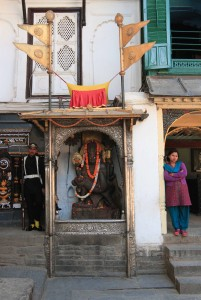 Inside Nasal Chowk, with a guard, a Hindu statue, and a disinterested woman.