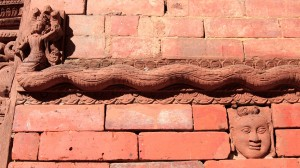 Cool wood sculpture built right in to the brick wall.