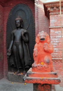Buddha relief statue in the back and a Hanuman statue in front.