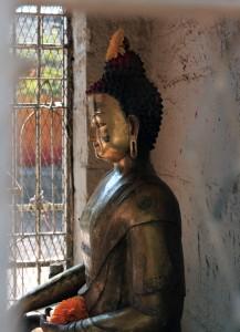 Caged Buddha statue.