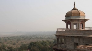Looking at the Taj Mahal (barely visible in the haze) from Agra Fort.