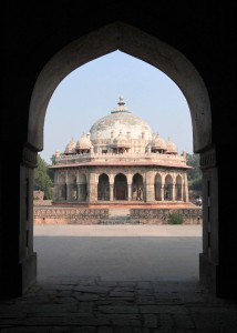 Looking at Isa Khan's Garden Tomb through an arch belonging to the nearby masjid.