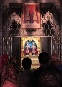 Worshipers inside Shri Swaminarayan Satsang Mandir.
